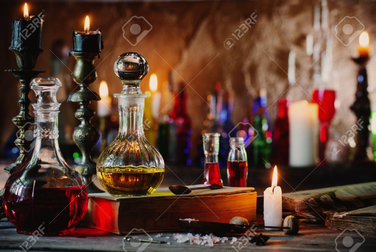 Magic potion, ancient books and candles - 83473140