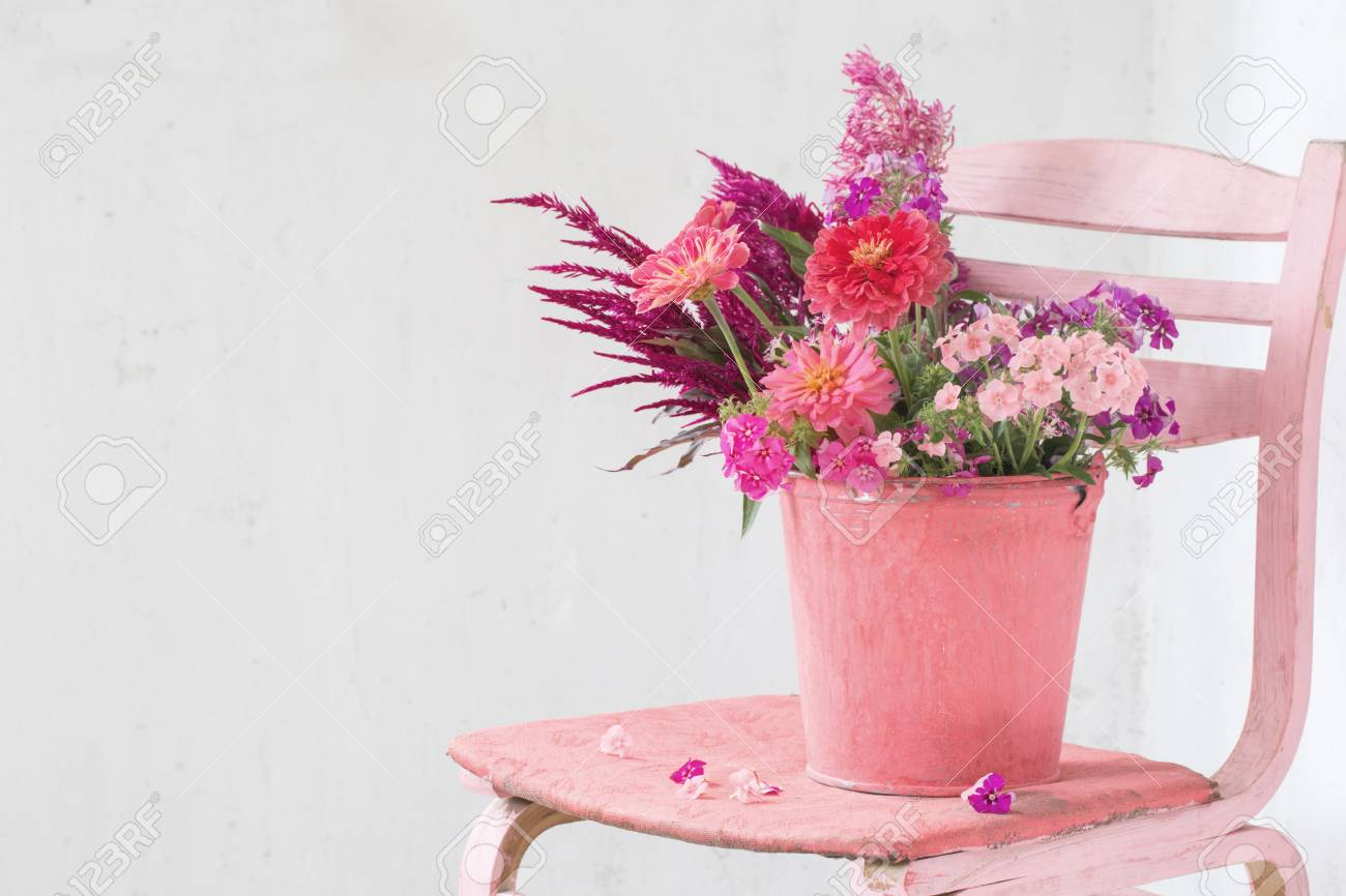 Pink Flowers In Bucket On White Background Stock Photo Picture And Royalty Free Image Image 86167396
