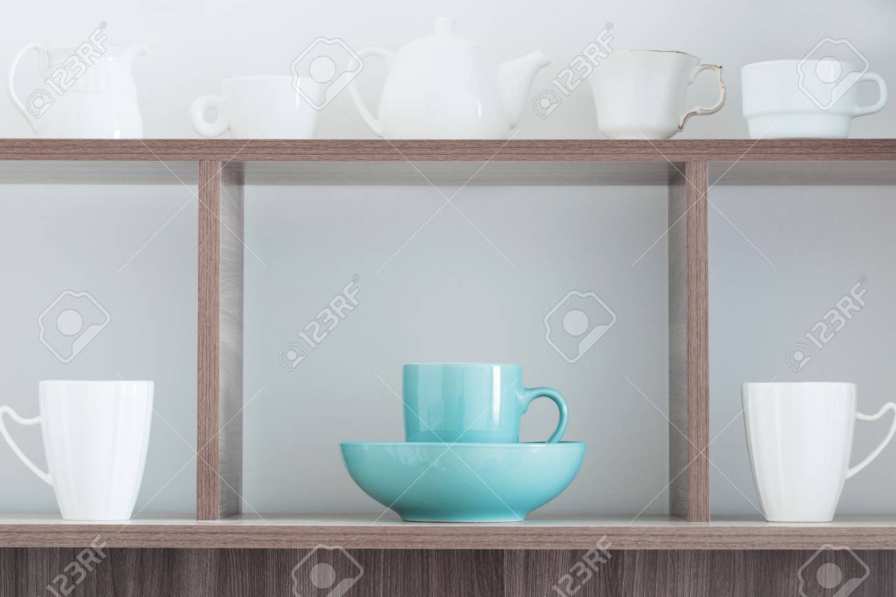 White Kitchenware On Wooden Shelf Stock Photo, Picture And Royalty ...