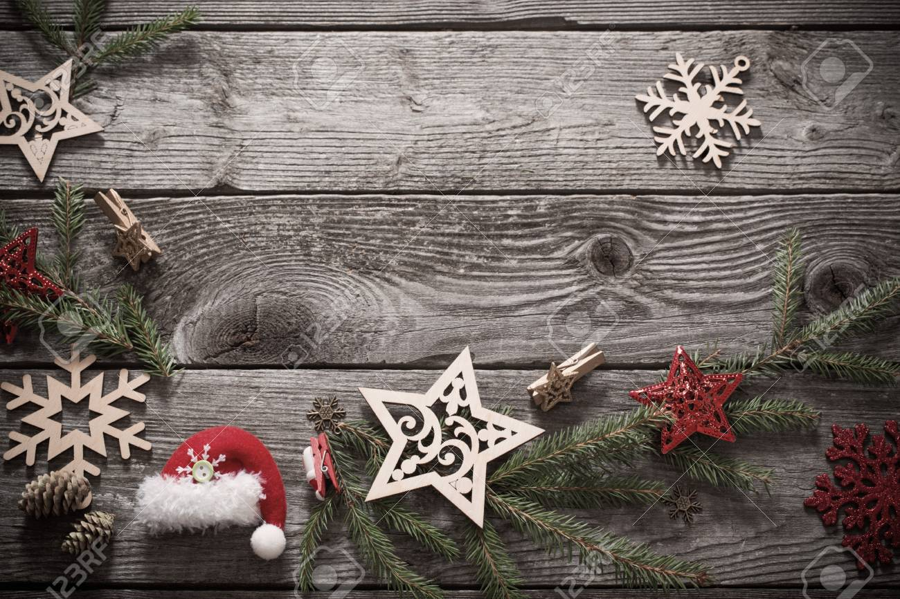 christmas decoration with fir branch on old wooden background foto