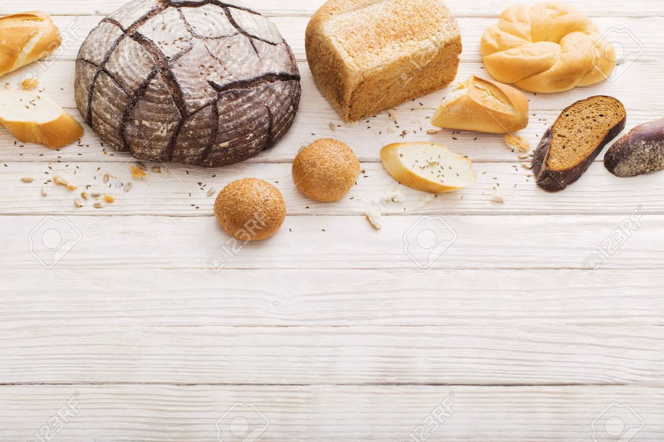 different types of bread on white wooden background - 120557295