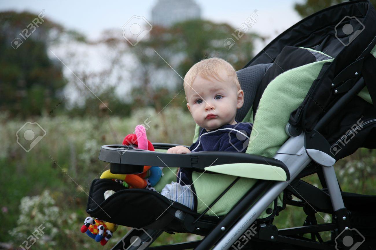 Baby Sitting In A Stroller Outside Stock Photo, Picture And ...