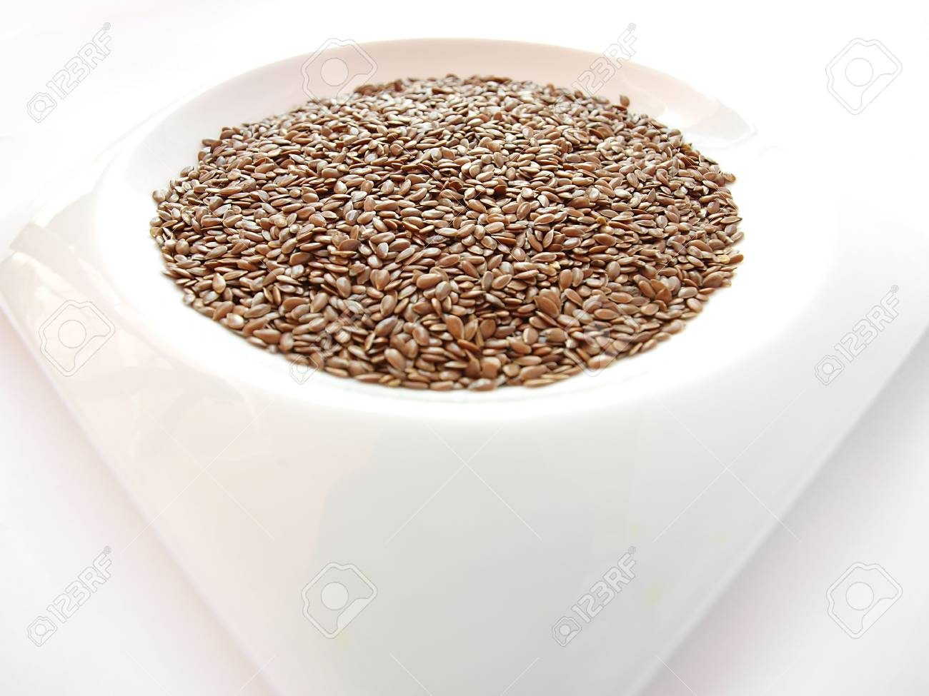 Bowl full of brown flax seed or linseed Stock Photo - 7774783