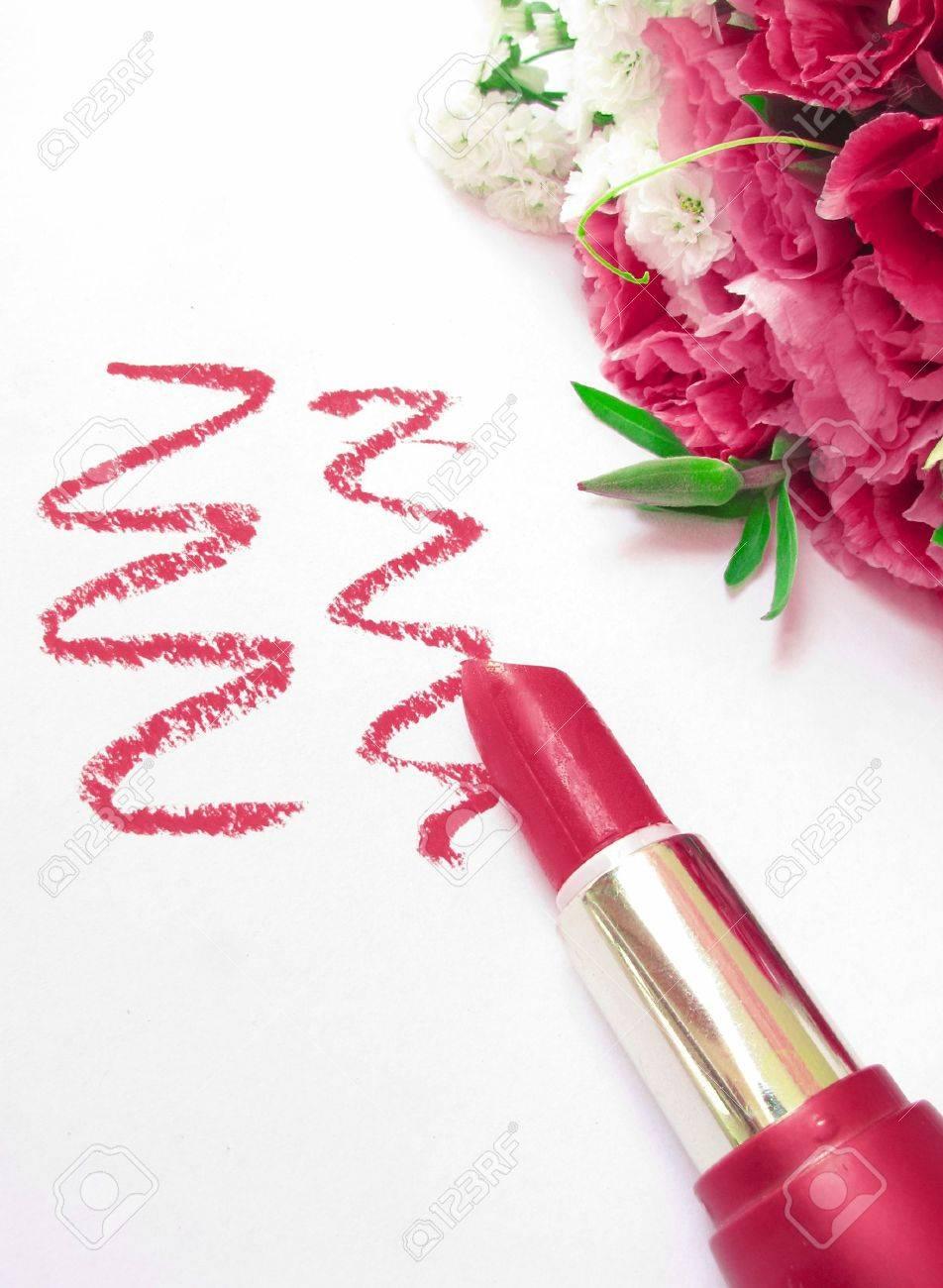 glamor shiny lipstick isolated on white background and flowers Stock Photo - 9710626