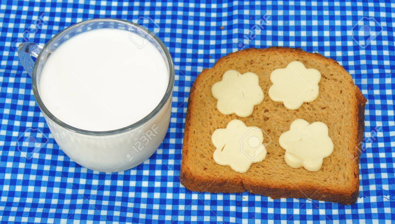 cup of milk and bread with cheese in flower shape Stock Photo - 13200100