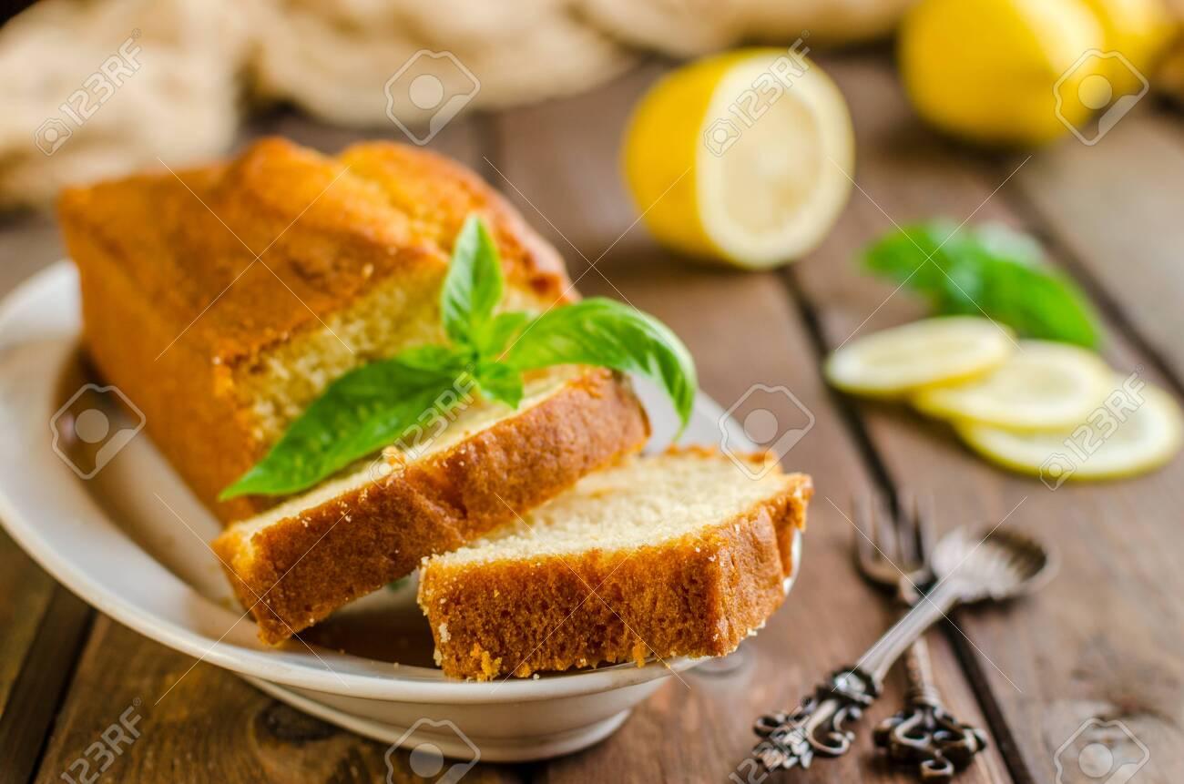 Lemon pound cake on rustic wooden background with lemon. - 136816706