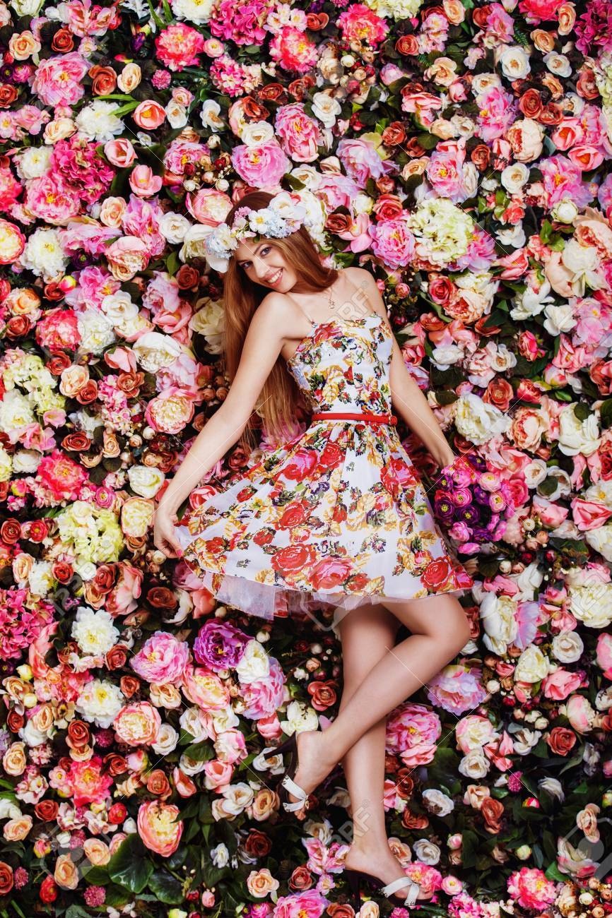 A beautiful young girl with flowers bouquet near a floral wall a beautiful young girl with flowers bouquet near a floral wall stock photo 37340581 izmirmasajfo Image collections