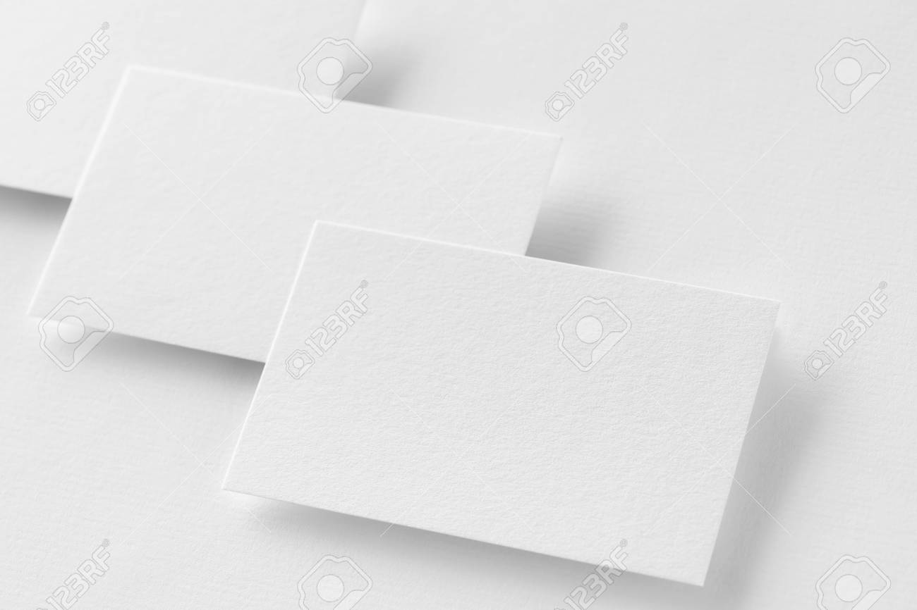 Mockup Of Three Horizontal Business Cards At White Textured Paper ...