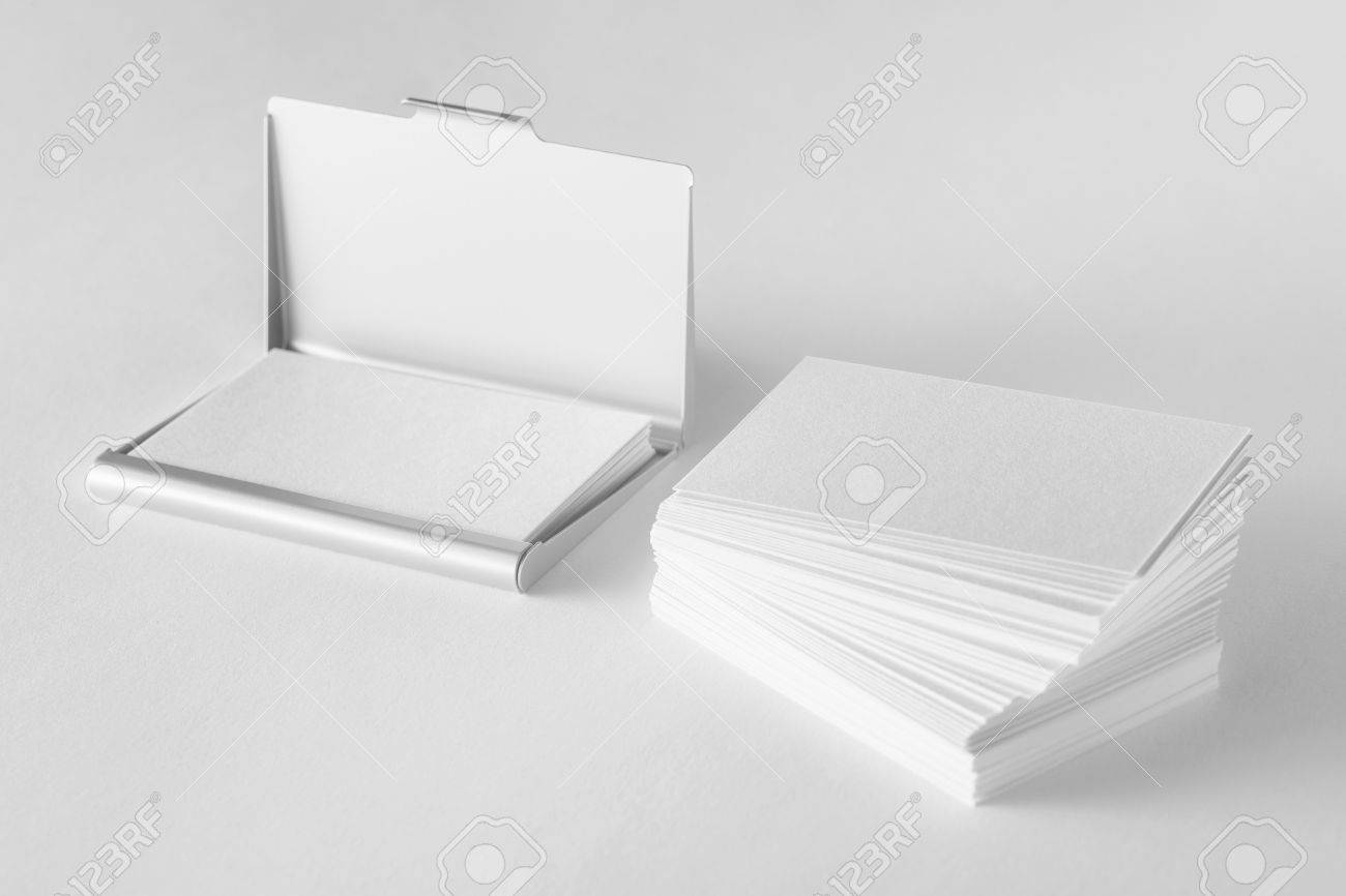Mockup of blank business cards stack and cardholder at white stock mockup of blank business cards stack and cardholder at white textured background stock photo colourmoves