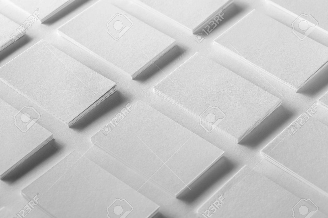 Mockup of horizontal business cards stacks arranged in rows at mockup of horizontal business cards stacks arranged in rows at white textured paper background stock colourmoves