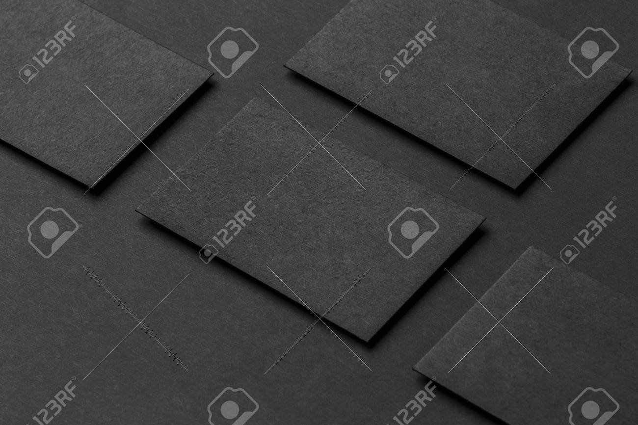 Mockup of four black business cards arranged in rows at black mockup of four black business cards arranged in rows at black paper background stock photo colourmoves