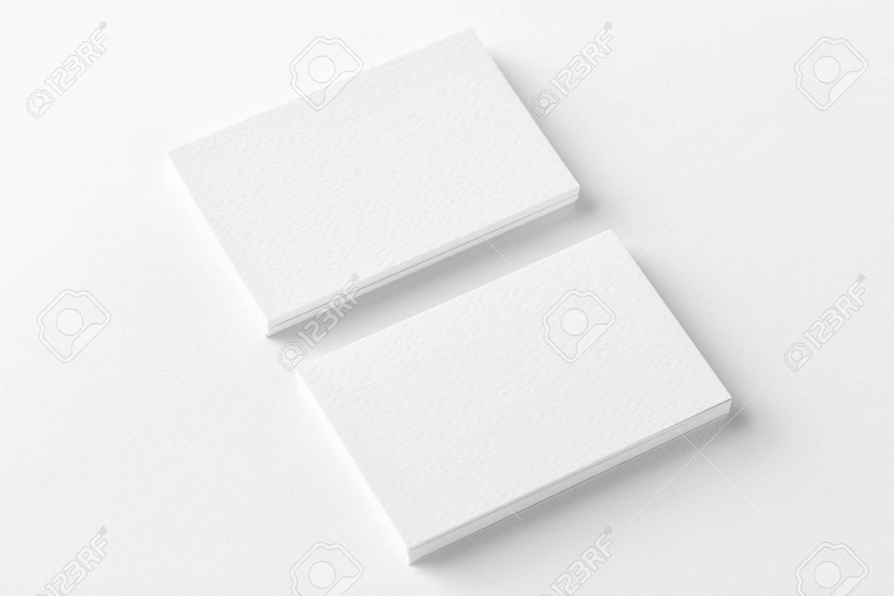 Mockup of two horizontal business cards stacks at white textured mockup of two horizontal business cards stacks at white textured background angle view stock photo colourmoves