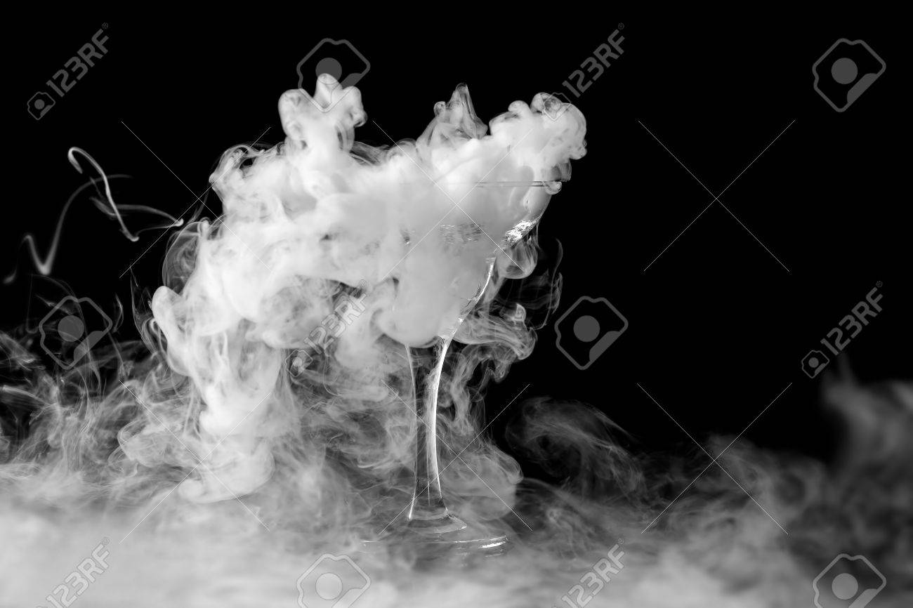 Closeup wine glass with fog at dark background chemical reaction of dry ice with water