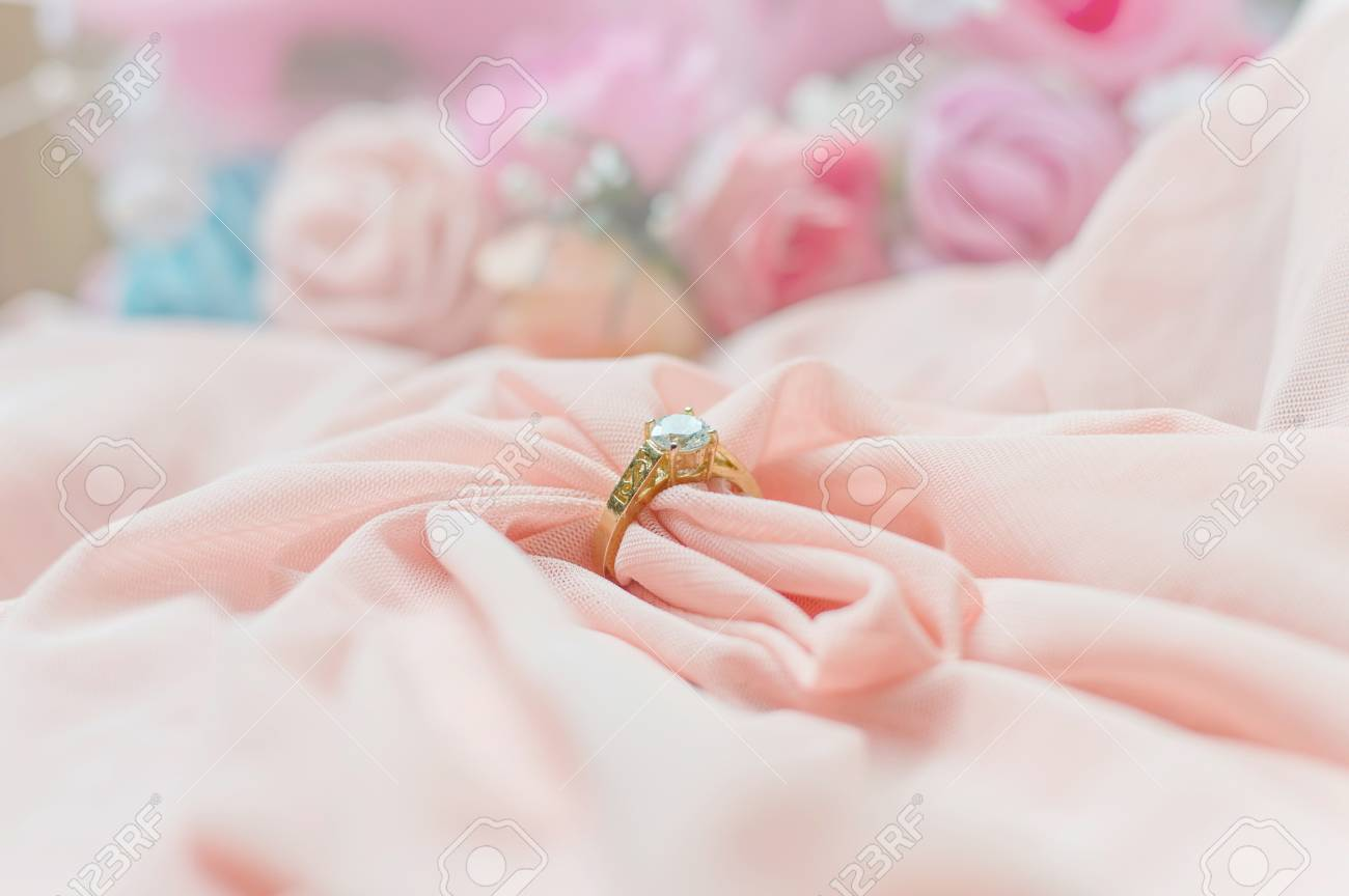 Close Up Of Diamond Ring On Pink Fabric For Valentine Day Or.. Stock ...
