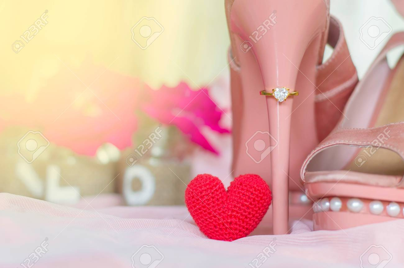 Gold Wedding Ring On Heel Of Pink Shoe With Red Heart On Pink ...
