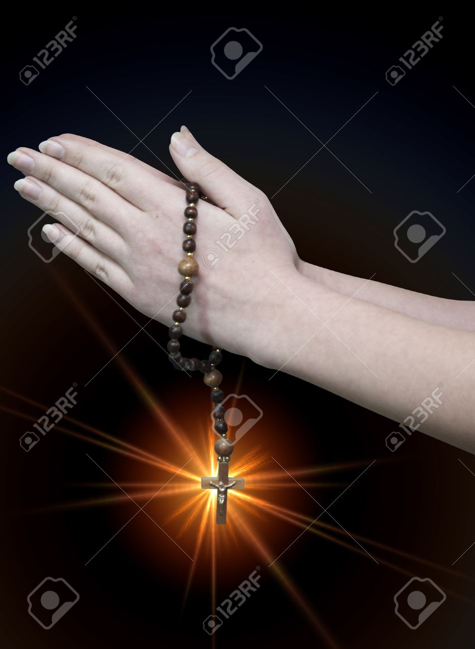 praying hands with rosary wooden Christian on a dark background Stock Photo - 11661872