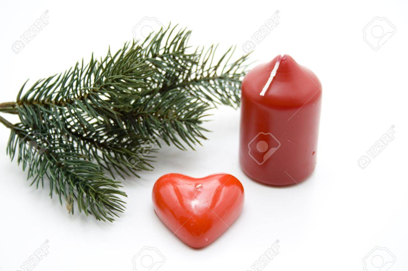 Fir branch with heart candle Stock Photo - 13082469