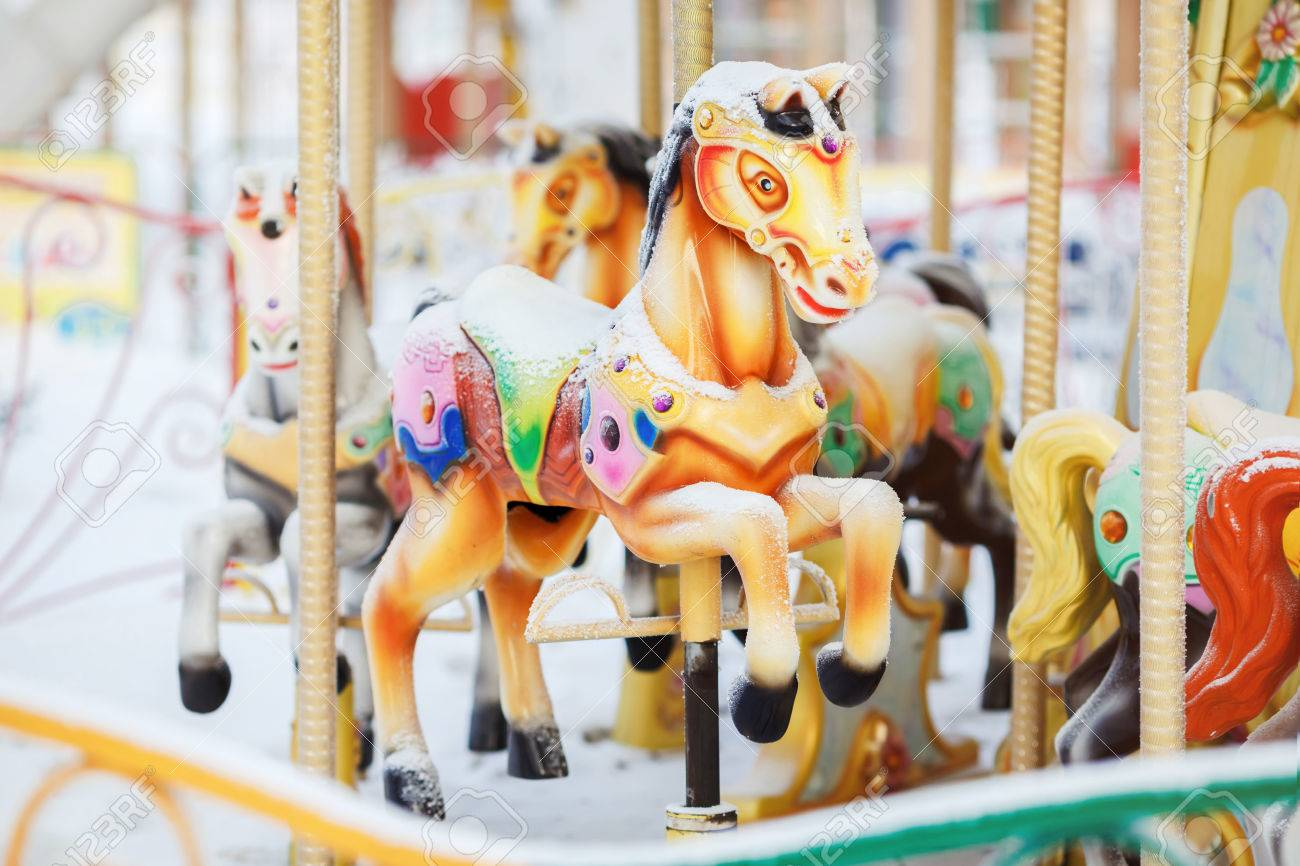 Fairground Carousel Horses During The Day Covered With Snow In Stock Photo Picture And Royalty Free Image Image 50900957