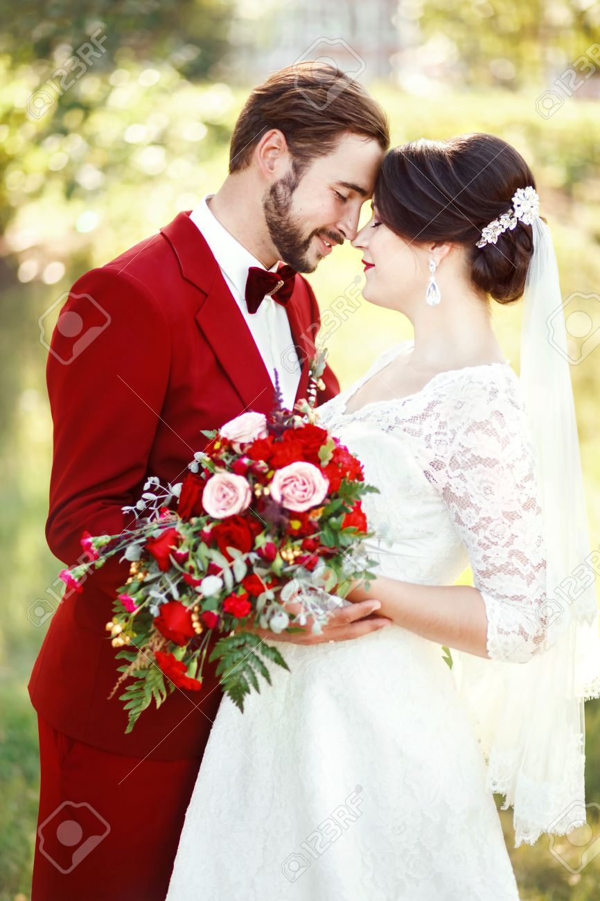 Marsala Wedding Couple Bride And Groom Embracing Dark Red Color
