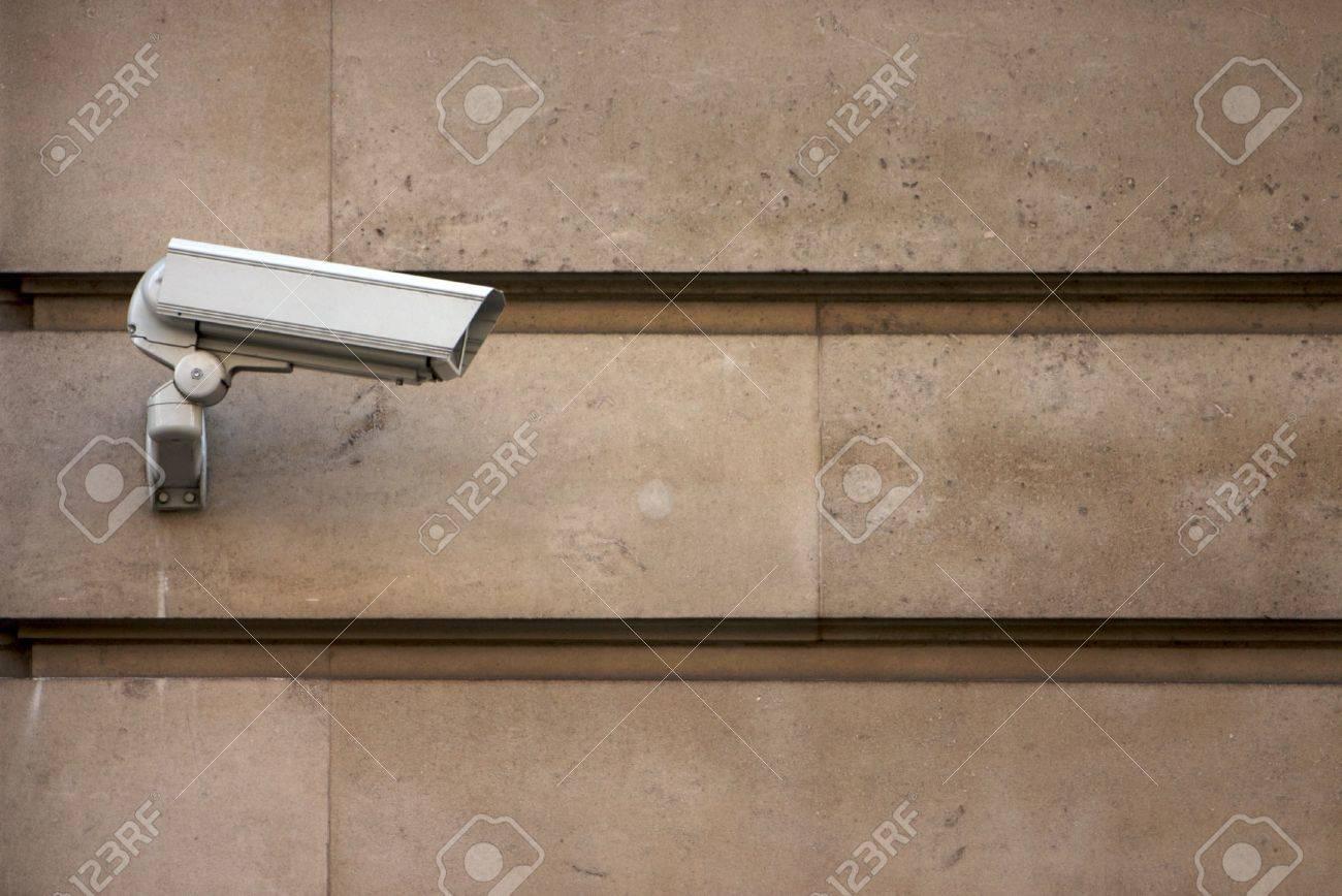 CCTV camera on stone-clad wall Stock Photo - 4148144