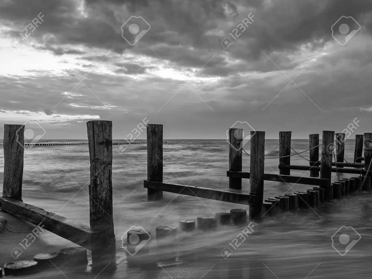 Monochrome image of a groyne in the Baltic Sea near to Zingst, Mecklenburg-Western Pomerania, at twilight - 155472855