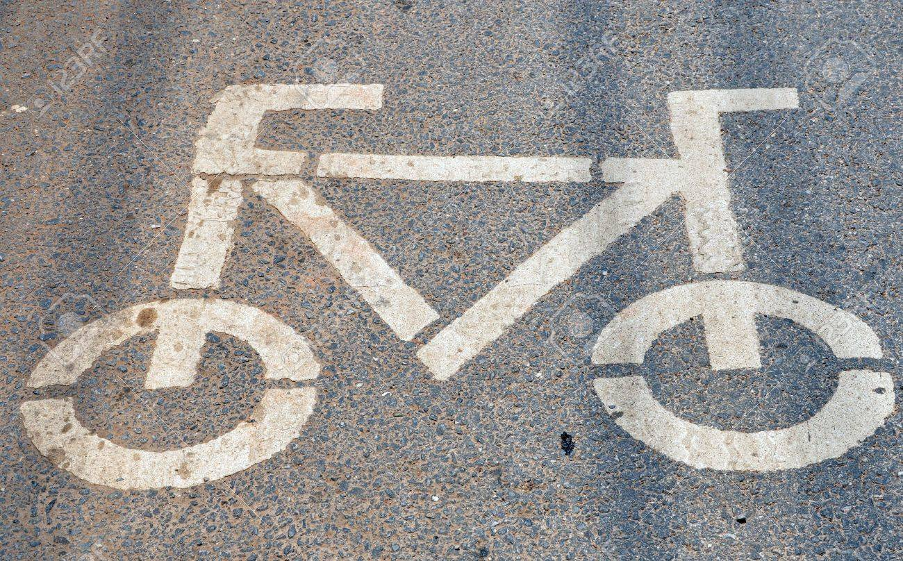 Bike lanes and road shoulders demarcated by a painted marking are quite common both in many European and American cities. Stock Photo - 10309619