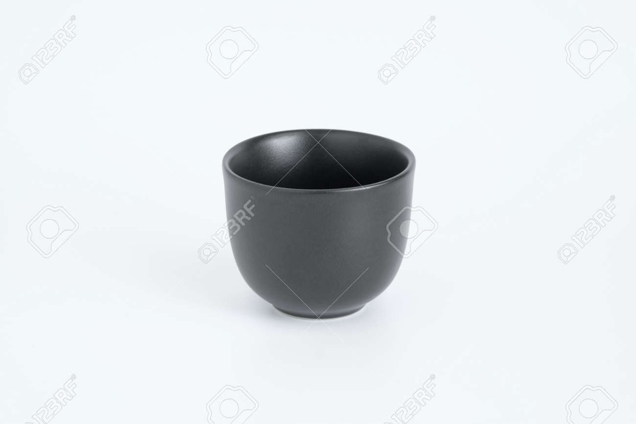 Japanese style black ceramic tea cup isolated on white background - 168610220