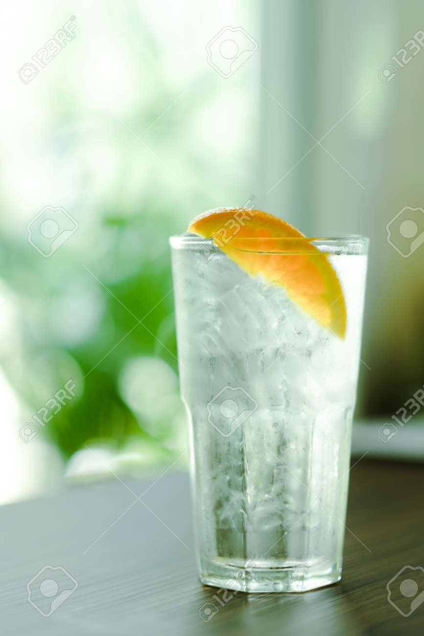 Refreshing water with ice and orange - 168610102