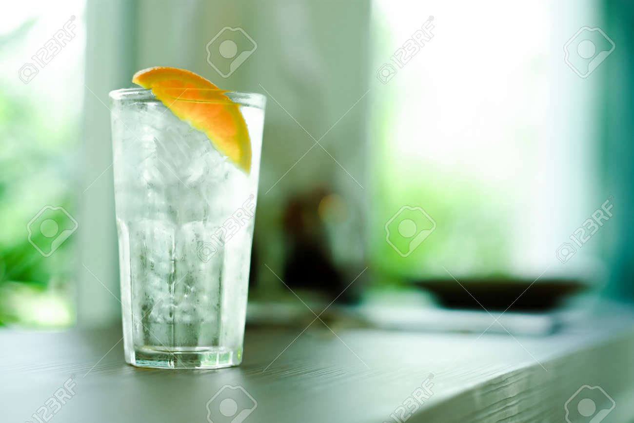Refreshing water with ice and orange - 168610036