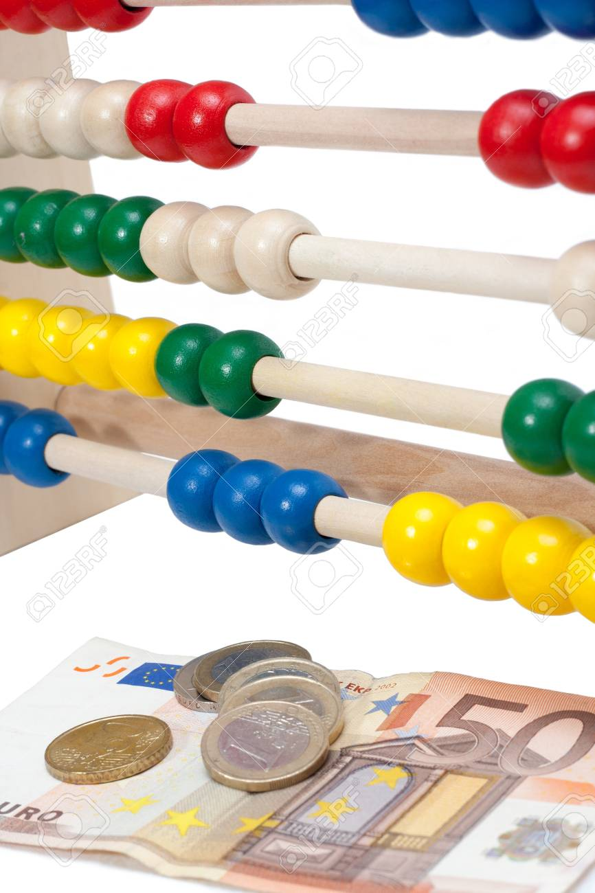 Close up of a colored children sliderule with money Stock Photo - 15327158