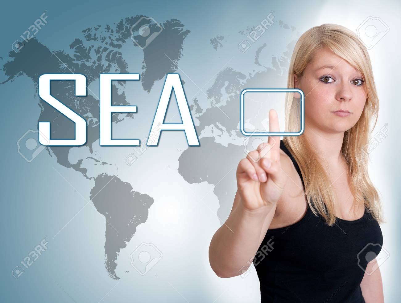 Young woman press digital SEA - Search Engine Advertising button on interface in front of her Stock Photo - 30349818