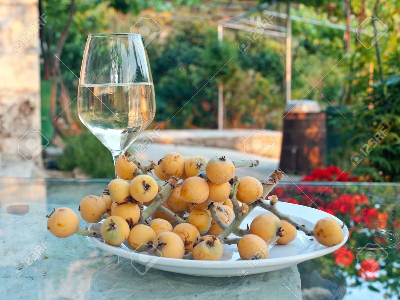 Glass of white wine with traditional mediterranean fruit - 12977385