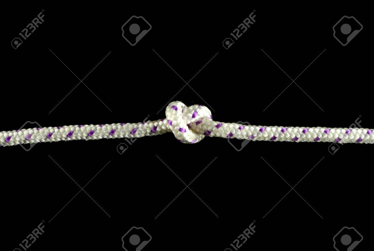 Close-up of a rope with knot isolated on black background Stock Photo - 10464684