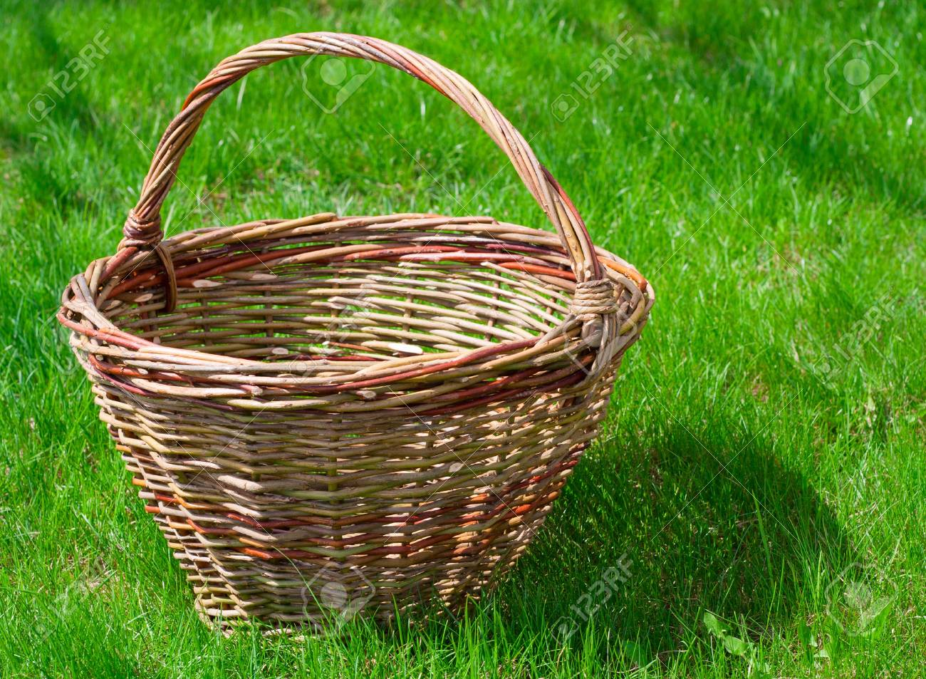 Old Wicker Basket On A Green Garden Grass Stock Photo, Picture And ...