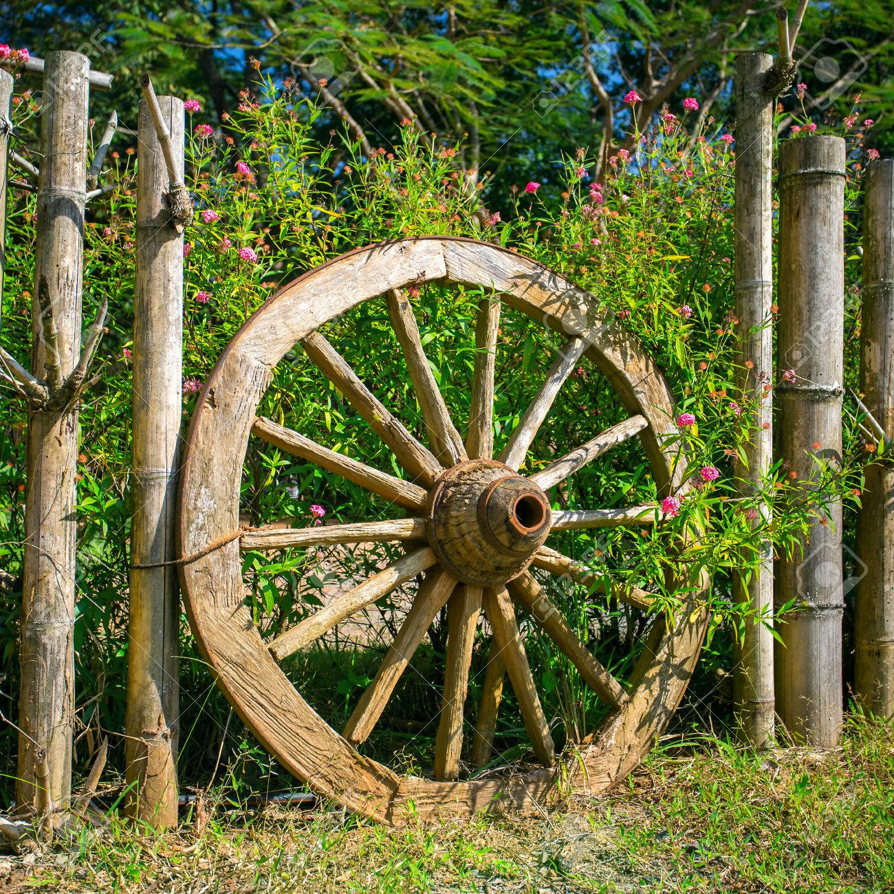 An Old Wagon Wheel Displayed As A Garden Decoration Stock Photo Picture And Royalty Free Image Image 36813224