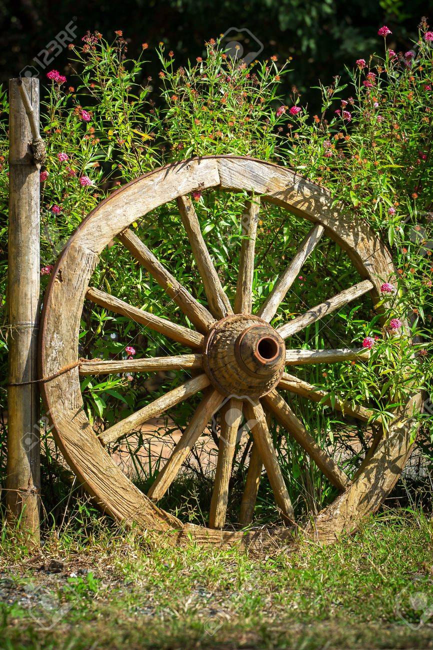 An Old Wagon Wheel Displayed As A Garden Decoration Stock Photo Picture And Royalty Free Image Image 36813225