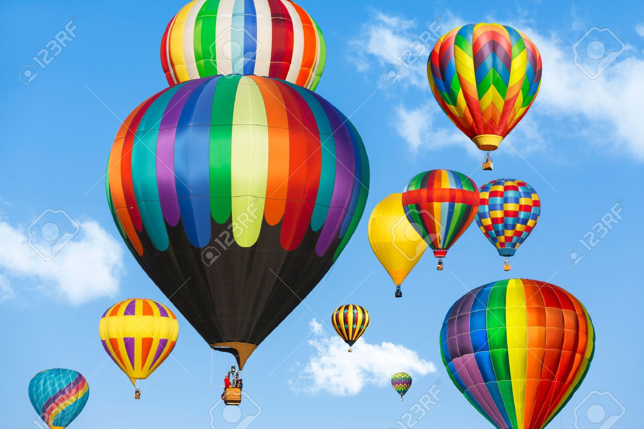 Colorful hot air balloons over blue sky. - 43822960