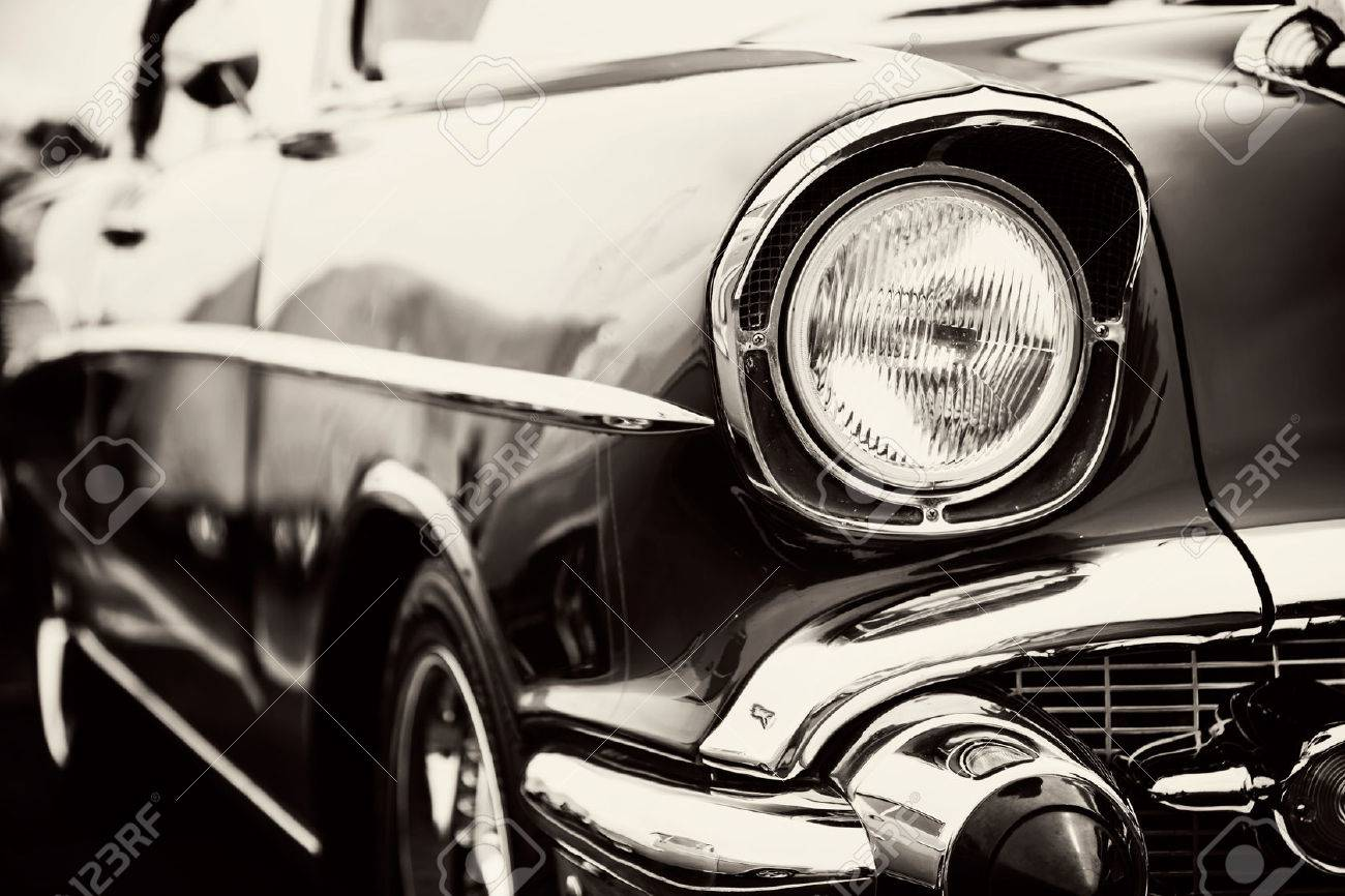 Classic car with close-up on headlights - 52533933