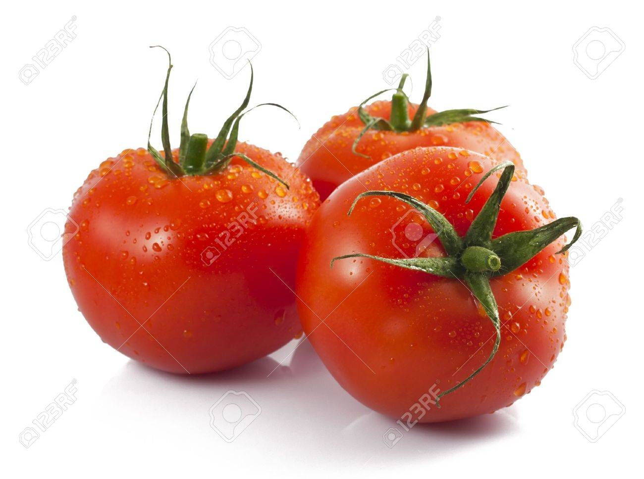 Three ripe tomatoes with water drops - 7979665