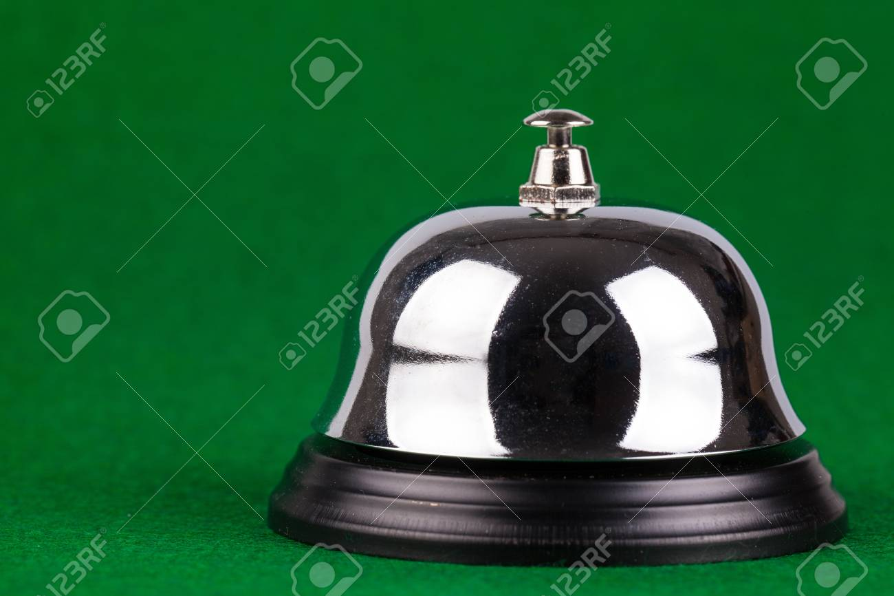 Silver alarm service bell on green background Stock Photo - 17247194