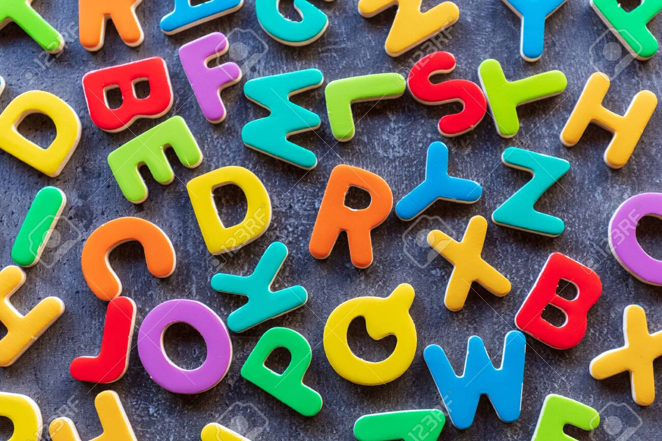 colorful mixed letters pile on a granite table, top view - 153365507