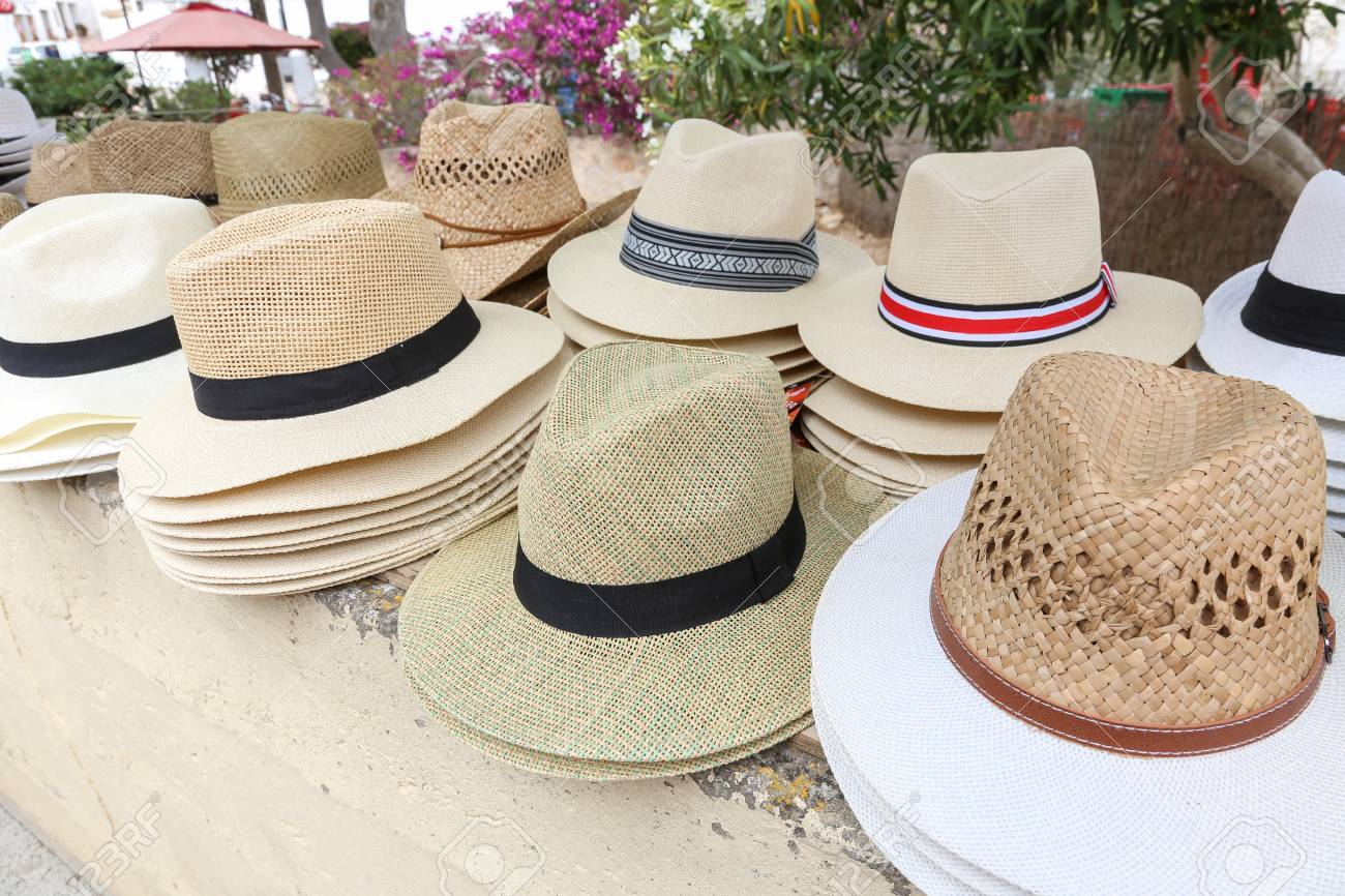 Stock Photo - Summer straw men s hats on display for sale to be used for  protection from the sun. c1c94a5d7ab