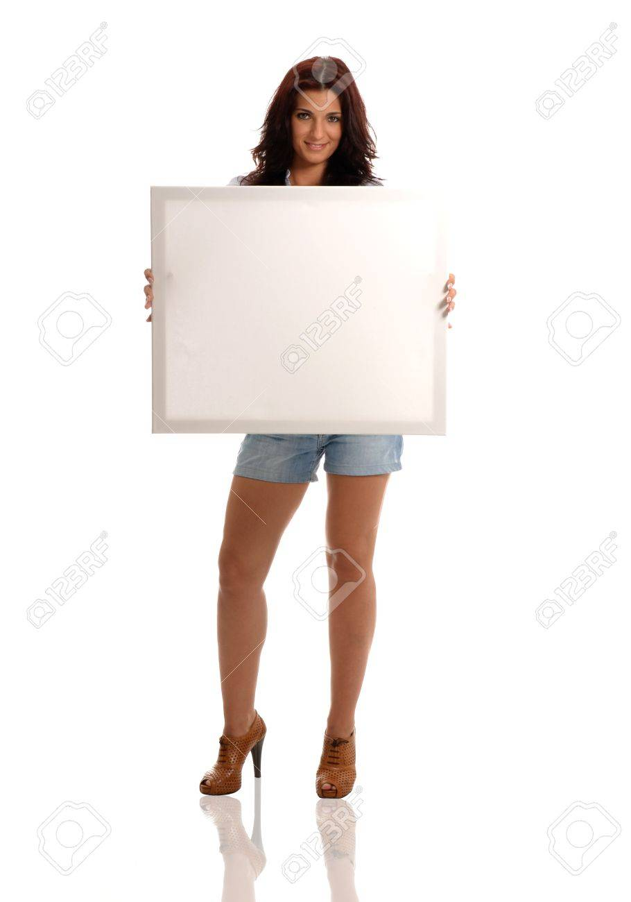Sexy brunette with empty white billboard in hands Stock Photo - 14904048