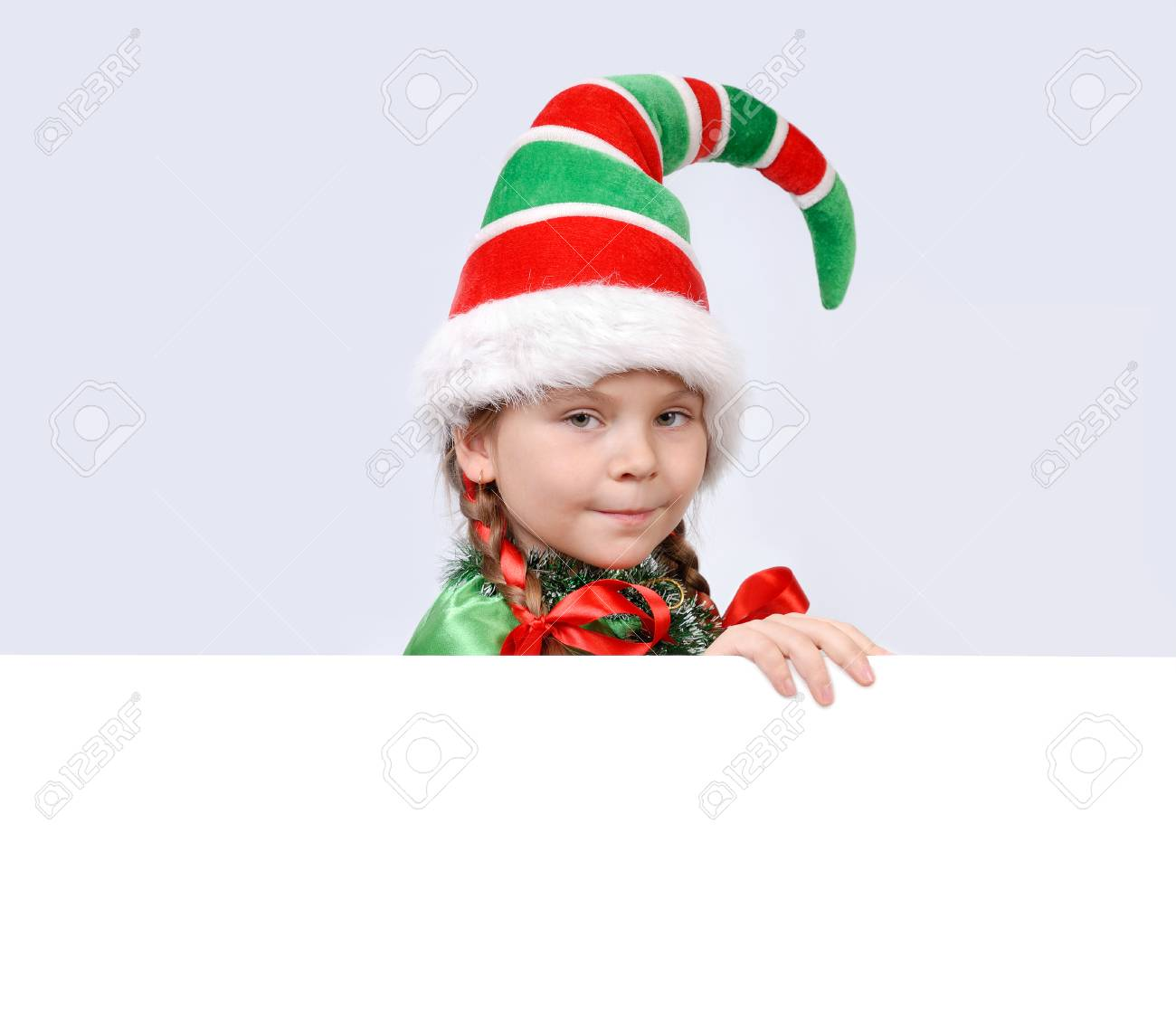Girl In Suit Of Christmas Elf With The White Banner Stock Photo ...