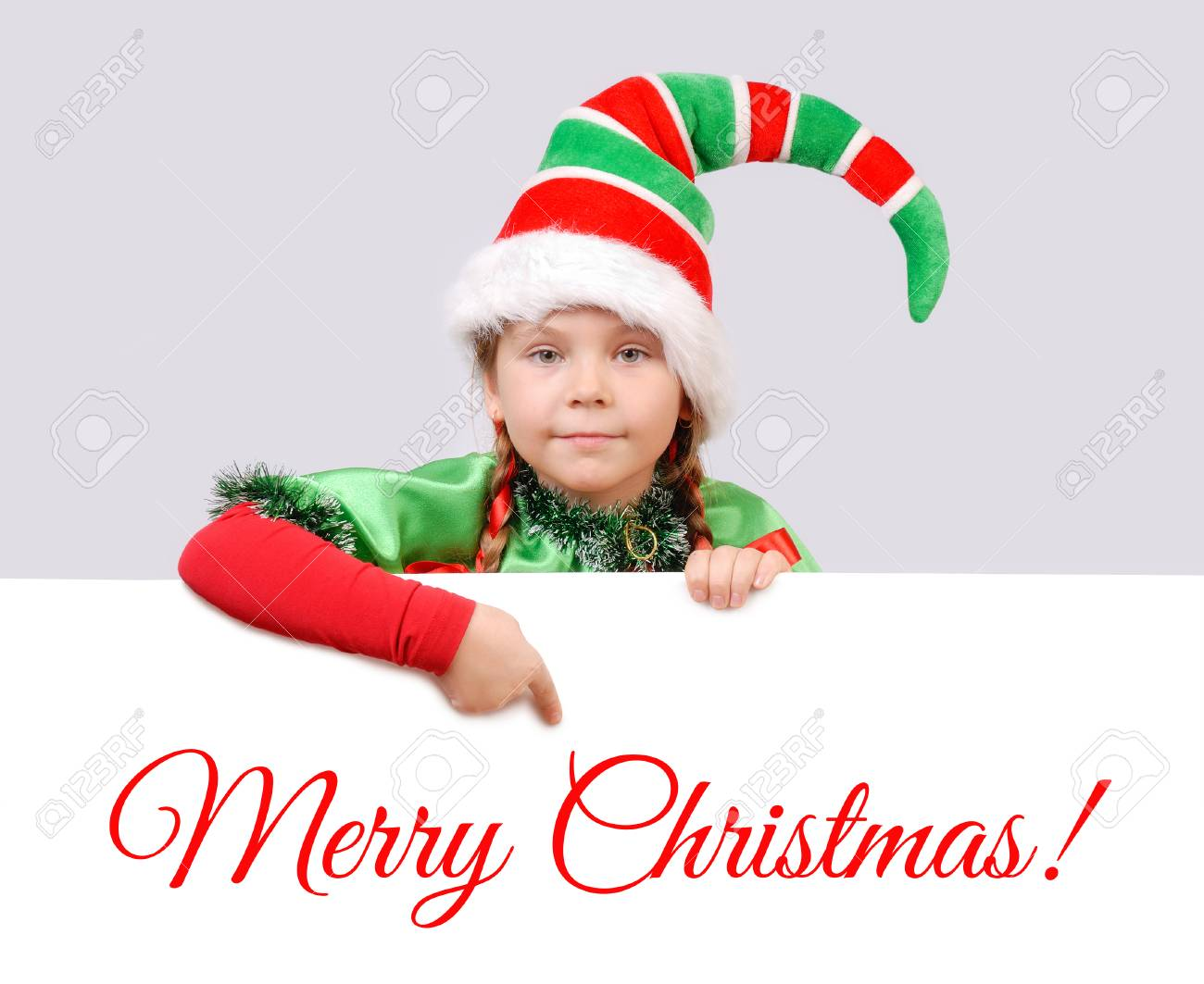 Girl In Suit Of Christmas Elf With The White Banner. Background ...