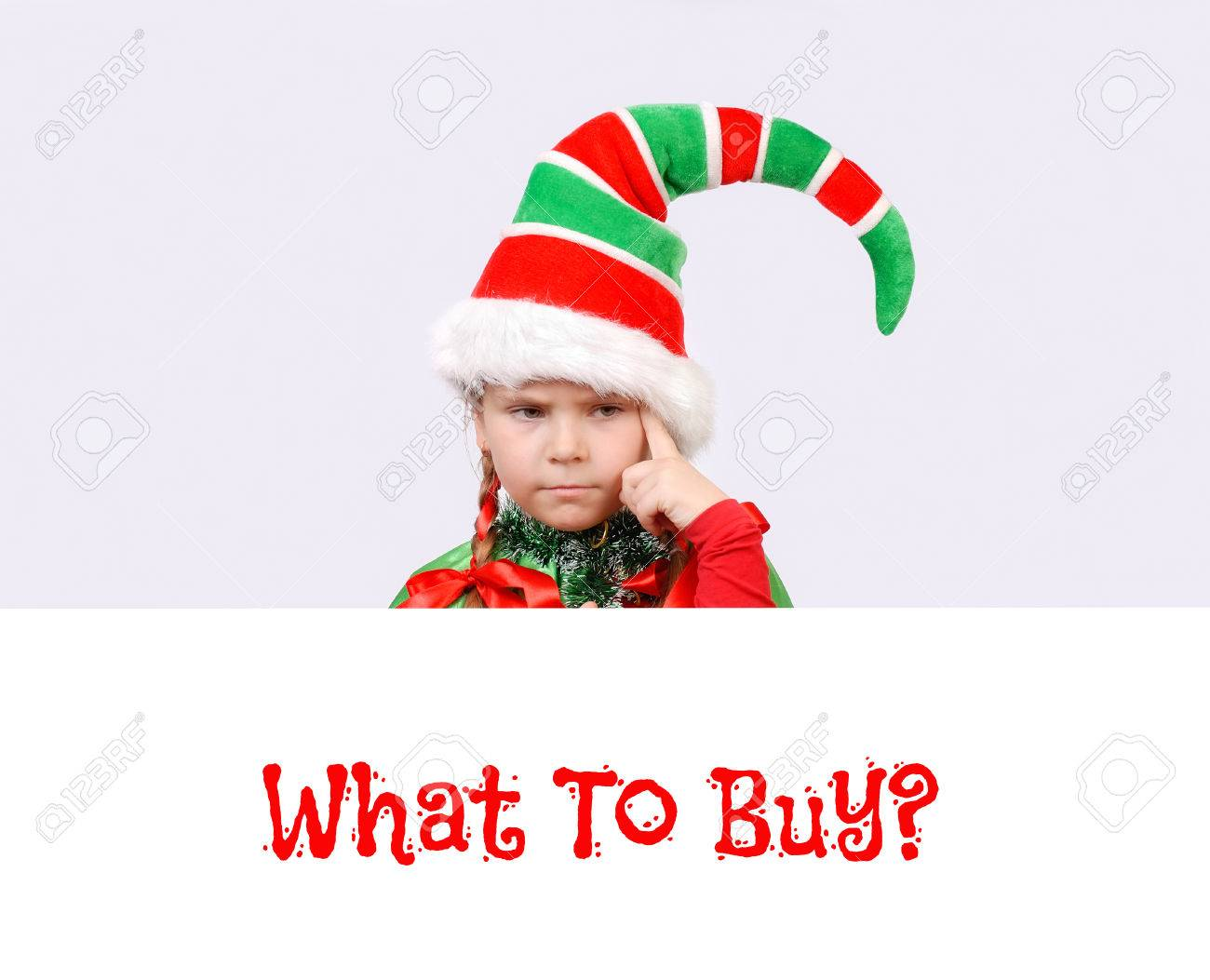 Girl In Suit Of Christmas Elf With The White Banner Thinking.. Stock ...
