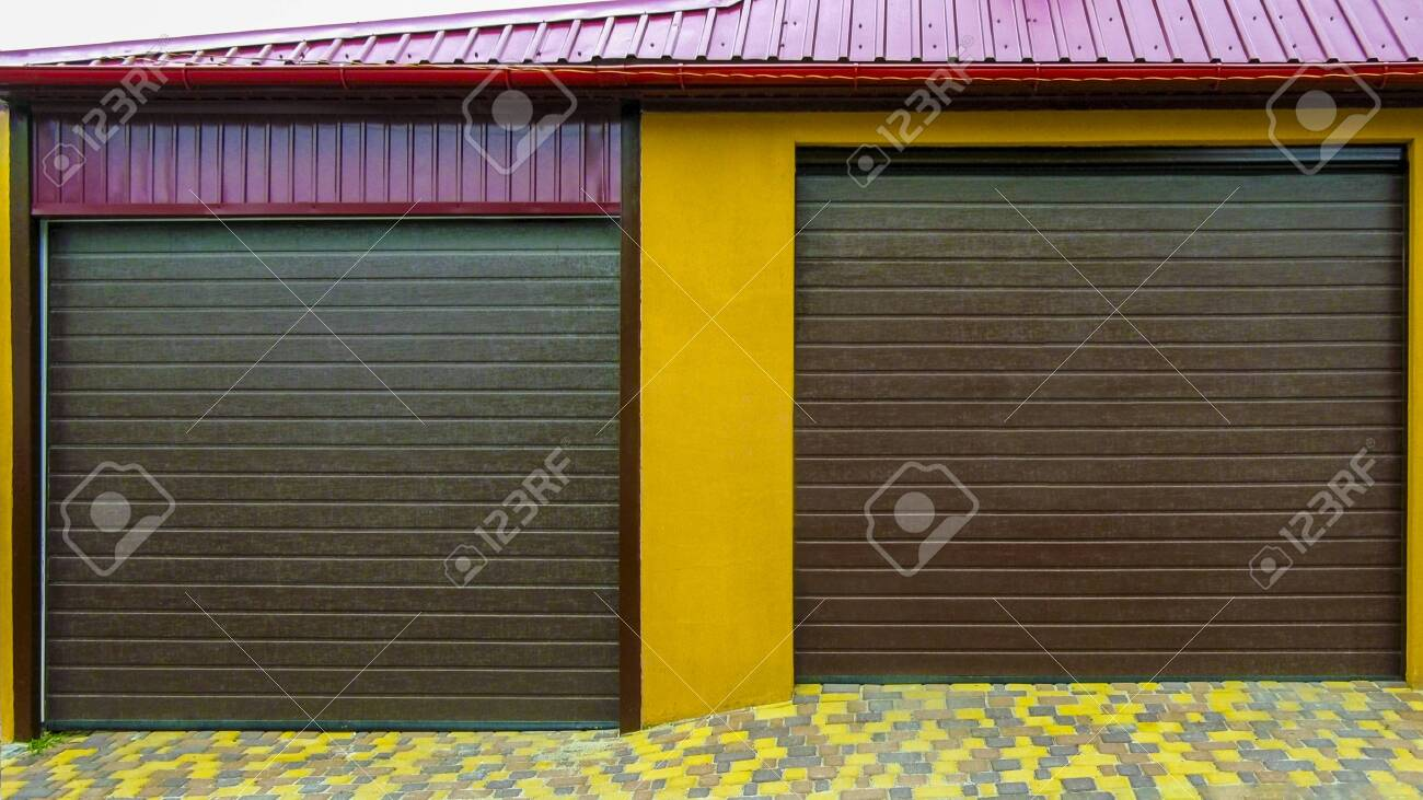 Brick Garage With Roller Shutters For Two Cars In A Residential Stock Photo Picture And Royalty Free Image Image 148361359
