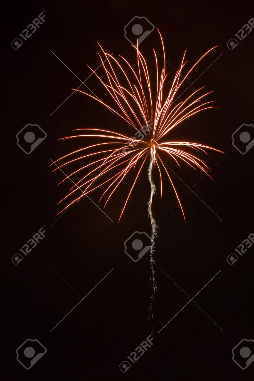 Red burst with sparkling tail against night sky Stock Photo - 1358306