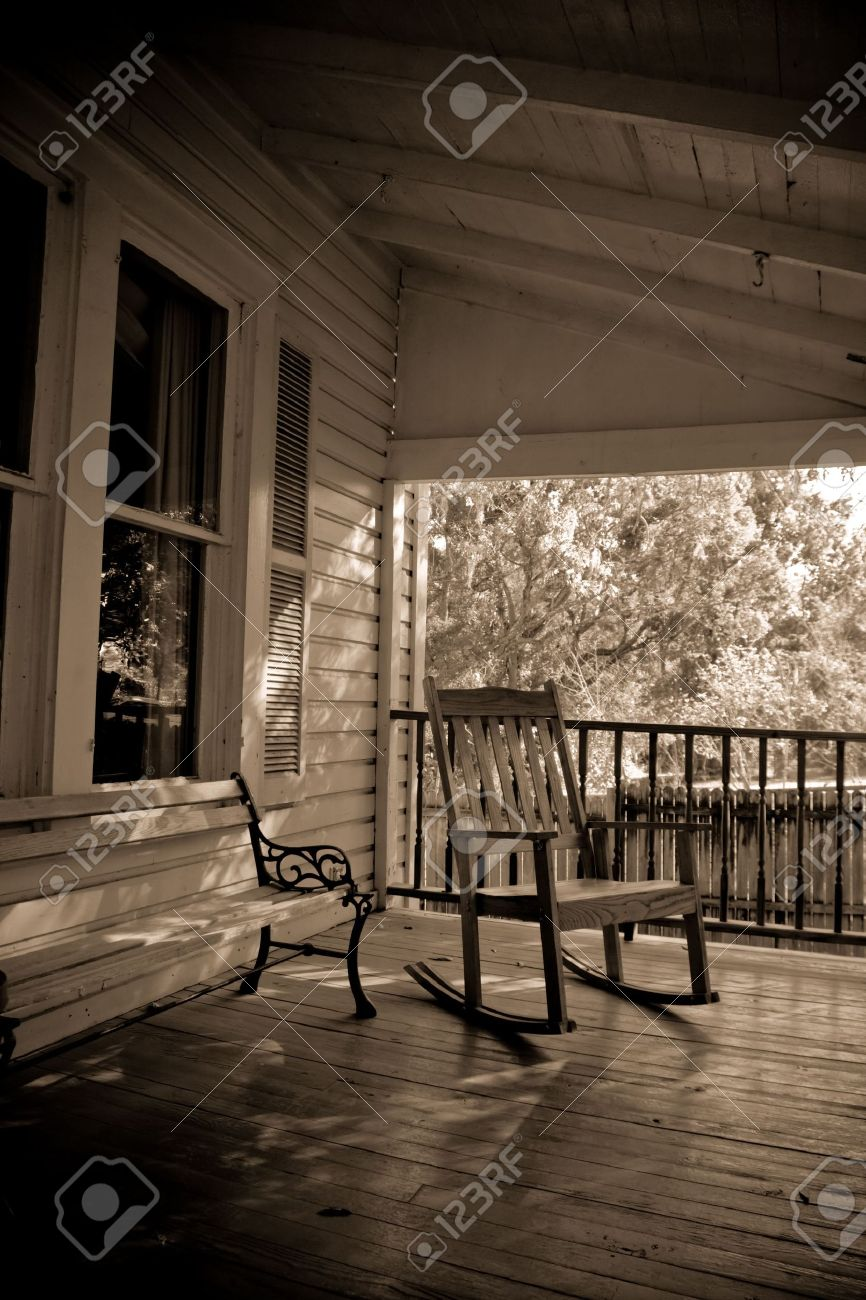 Sepia Toned Old Time Country Porch With Rocking Chair And Bench Stock Photo    2303366