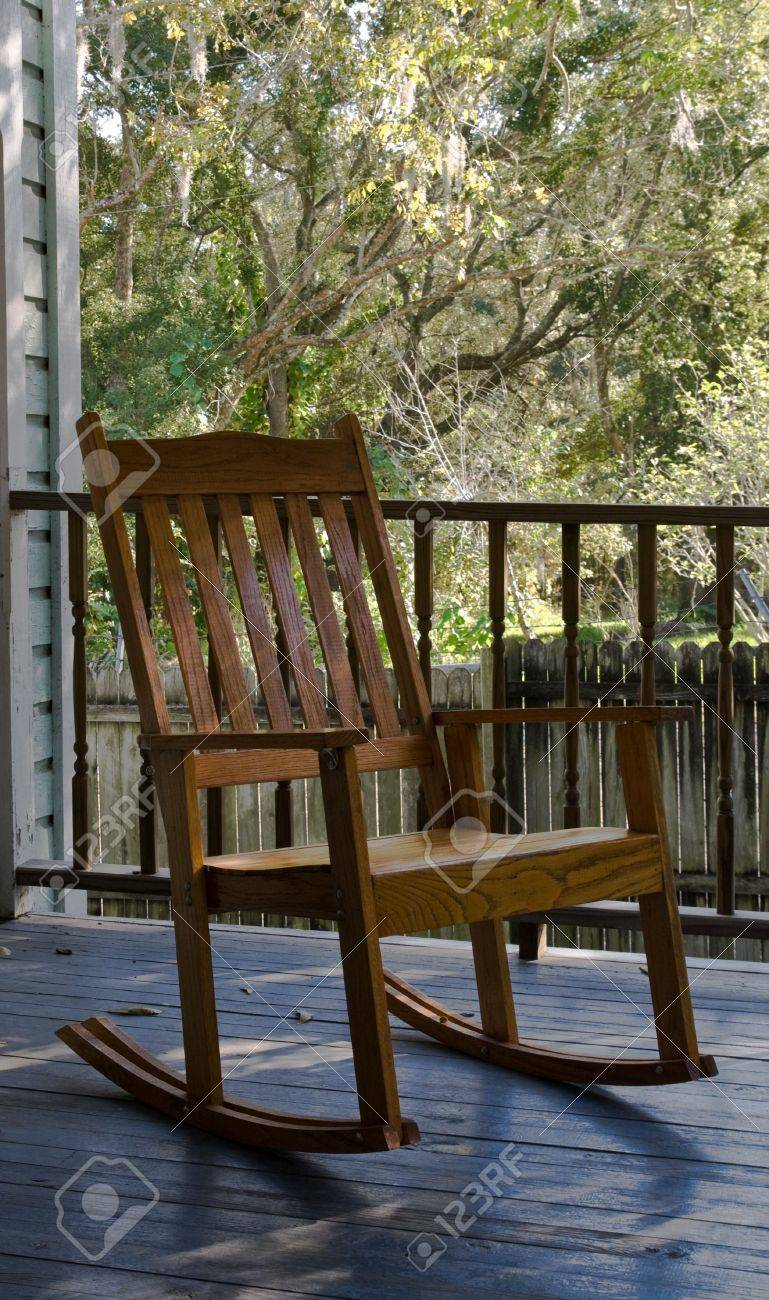 Cool Old Wooden Rocking Chair Sitting On A Porch Ncnpc Chair Design For Home Ncnpcorg